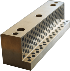 sliding liner with two sliding surfaces made from brass with graphite pins